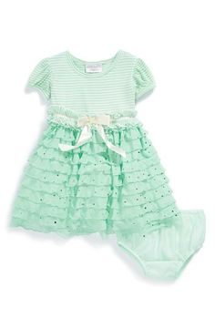 The metallic dots and frills are too cute on this dress and bloomers set.