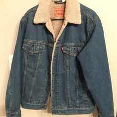 Levi's Jean jacket with fur inside size small, very warm, never worn, bought it a while back but I live in Orange County so it rarely gets cold enough to wear this lol. price negotiable! Levi's Jackets & Coats Jean Jackets