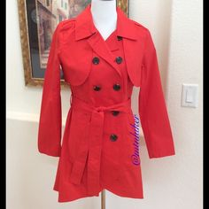"CAbi Convertible Trench Jacket NWOT, Poppy HP Wear it as a belted trench or open jacket. Zip the cape topper off & wear it as a sleeveless vest or shirtwaist dress with leggings or jeans. The fun poppy red color goes well with so much❤️ A must have for travel❤️ Styled w/ front pockets, epaulets, asymmetric hemline, double breasted ❤️ 98% cotton; 2% spandex. Machine wash ❤️ chest 42""; waist up to 39""; hip 41""; length in back 36.5""❤NWOT❤️Smoke free home❤️ Style Obsessions Host Pick by @ddstorm…"