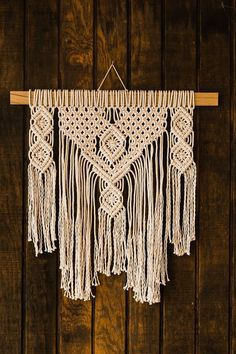 This symmetrical design looks great anywhere in your home! Dimensions: Pine wood is long Macrame is 20 inches wide and 27 inches long (from hanger to fringe) Macrame Wall Hanging Patterns, Large Macrame Wall Hanging, Macrame Art, Macrame Design, Macrame Projects, Macrame Patterns, Art Macramé, Macrame Tutorial, Diy Interior