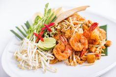 "Jim Thompson Restaurant and Wine Bar ""Phad Thai Goong Sod"" Traditional Thai-style fried noodles with prawns.  #thaifood #thairestaurant #jimthompson #bangkok #thailand"
