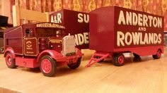 Scratchbuilt from wood to the scale of 1 / 24th. Model of Scammell Showtrac and box trucks