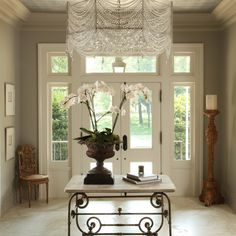 A stunning entryway. The gorgeous crystal chandelier commands your full attention.