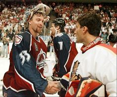Colorado Avalanche goaltender Patrick Roy shakes hands with his counterpart Florida Panthers John Vanbiesbrouck following Game 4 Stanley Cup Finals Monday June 10, 1996 in Miami.