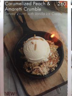 Caramelized peach and amaretti crumble with ice cream.