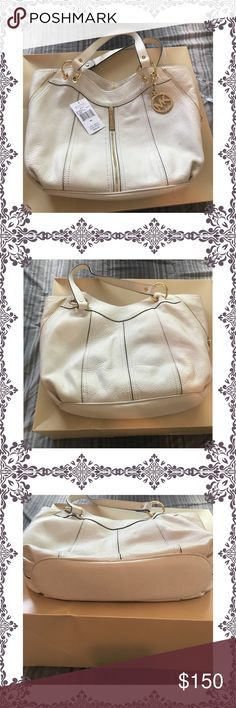 White michael kors bag A cute michael kors bag... bought last june.. used ones.. and stayed on my closet inside the box the whole time.. then deside to use again when noticed this stain looking thing by the pocket.. so deside to sell.. offers welcome guys... highest bidder wins 😅 Michael Kors Bags
