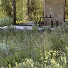 natural materials (rusted steel) blend with native landscape