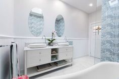 Unusual patterned blue feature tile in this Hamptons Country style bathroom.