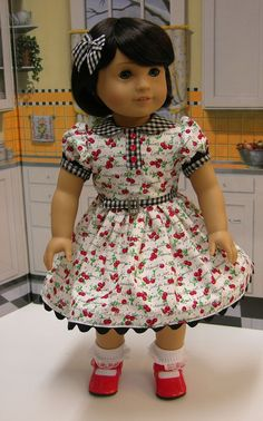 Adorable customized dolly in adorable cherry dress. :)