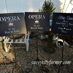 Old opera music stands repurposed With chalkboard paint and lettering! Maybe the greatest most exciting thing I've ever bought at auction! www.savvycityfarm...