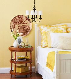 Follow the rule of three: When you pick a color, use it at least three times in a room. Here, yellow appears in the pillows, on the blanket on the bed, and as an accent color on the nightstand, as well as on the walls.