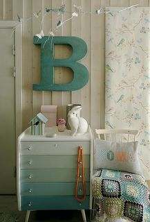 You pick your gradient colors from a color swatch, buy samples of each color, and paint the drawers! So Cute!