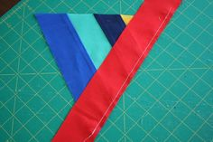 For this project you need: – A Bella Solids Jelly roll (or you can use 2.5″ scraps…but you'll need some that are really long) – A starter triangle (cut from fabric about 5″ square) – Batting and linin