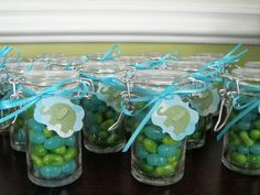 """Baby shower favors - little favor jars with kiwi and berry blue Jelly Belly candies and elephant tags with """"thank you"""" stamped on the back"""