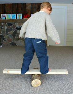 Gross motor activity for preschoolers - log balancing! Great for a rainy day or a snow storm to let kids blow off some steam!