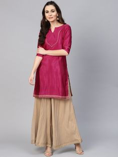 Magenta solid straight kurta, has a notched round neck, three-quarter sleeves, straight hem, side slits