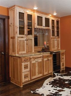 Hickory Wet Bar Cabinets- Hate the finish but like the upper cabinet configuration going all the way down on either end, could hide a blender or other small appliance Wet Bar Cabinets, Hickory Kitchen Cabinets, Upper Cabinets, Cabin Kitchens, Basement Remodeling, Basement Ideas, Kitchen Styling, Log Homes, Kitchen Design