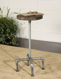 Uttermost 25002 Natural Iron Riveter Round Stool by Uttermost. $129.80. Material: METAL+WOOD. Natural iron pipe fitted with antiqued, old wood seat.