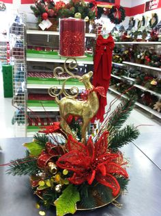 Inspiration to use my reindeer in a centerpiece Christmas Floral Arrangements, Christmas Table Centerpieces, Xmas Decorations, Christmas Projects, Christmas Home, Christmas Holidays, Christmas Flowers, Christmas Candles, Holiday Wreaths