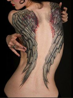 The blood at the root of these wings gives them the appearance of recently popping out of the body. #InkedMagazine #wings #wing #tattoo #tattoos #ink #Inked