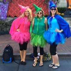 DIY Flora Fauna Merryweather Disney costumes sleeping beauty fairies tulle skirts embellished felt hats sewn capes pink green blue mickey's Halloween party