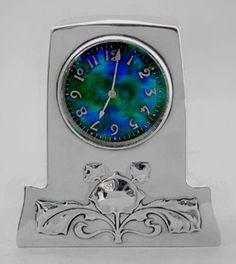 Archibald Knox. Liberty  Co. Silver clock