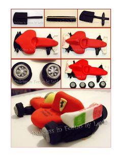 F1 Car. It is created by http://blog.giallozafferano.it/dulcisinforno/ferrari-f1-in-pasta-di-zucchero-tutorial-passo-passo/