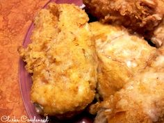 Delicious and moist, this baked fried chicken is amazing -- it tastes just like KFC....but even better, because it's homemad…