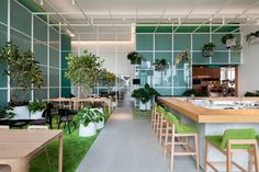klein dytham architecture has recently completed 'open house', a multi-use space contained within AL_A's central embassy building in bangkok. Restaurant Concept, Cafe Restaurant, Restaurant Interiors, Architecture Photo, Contemporary Architecture, Cafe Concept, Tropical Landscaping, Retail Interior, Plant Design