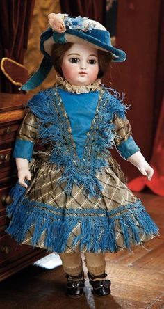 """Early French Kid-bodied Bisque Bebe by Gaultier with Block Letter Markings 14"""" (36 cm.) Bisque swivel head on kid-edged bisque shoulder plateFrench kid bebe body with gusset-jointing at hips, knees and elbows, bisque lower armsMarks: F. 4 G. Gaultier, circa 1878, earliest period bebe by that firm"""