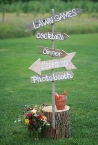 Wooden arrow signs directing wedding guests during the reception. | Alexander's Contemporary Cuisine & Fine Spirits | Fish Creek, Door County