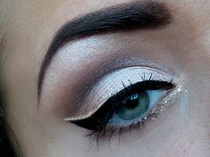 Add an outline of glittered eye liner around winged black eyeliner to give an everyday/simple look a nice touch.