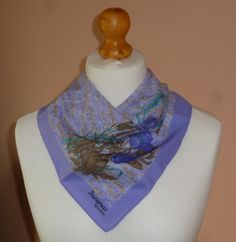 Late 1970s vintage Jacqmar of London square vintage head scarf with a poppies design against an abstract field of grass. lovely lilac colouring