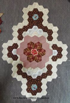 My Birds in the Loft hexagon quilt is growing under my fingers! I've now stitched together the first couple of rounds that will form the cen...