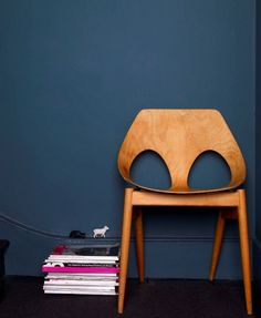 kandya jason chair against ink blue wall