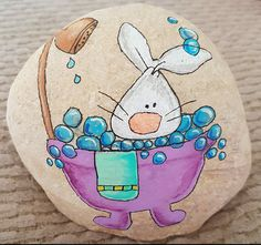Bunny rabbit taking a bath painted rock
