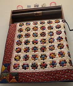 Sew'n Wild Oats's yo-yo quilt. A Kim Diehl design - notice the corners too