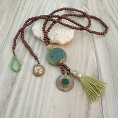 Long Mala Tassel Necklace in Green and Brown with Vintage Tribal Gypsy Coin Pendant