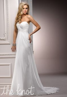 I love lace... but something about the simplicity of this dress is fantastic. <3 Gown features corset bodice.