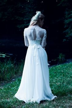 Model: shades 005 Description: corsetry wedding dress of milky shade with sleeves and an open back. The bodice and skirt are decorated with small