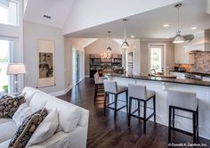 This open floor plan showcases the kitchen, great room, and dining! The Hartwell home design #1221