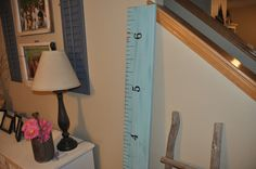 """A favorite for sure! 6 feet tall and 8"""" wide with hand painted lines and numbers.  Measurements begin at 6"""" to allow for baseboards and go to 6'6"""" unless requested otherwise. Each one is unique.  This ruler is made to look as though the paint is worn - as you are able to see the dark stain beneath the paint. If you prefer one with no blemishes or one with a lot of character, please let us know and we will do our best to get the piece of lumber that is perfect for you!"""