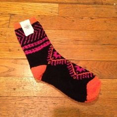 Super Soft & Fuzzy Printed Socks by Free People These socks are in brand new condition and have never been worn.  They are black, orange and pink and crazy soft. Please let me know if you have any questions. I offer a 20% discount on 3+ bundles!  I am open to reasonable offers but no trades. Free People Accessories Hosiery & Socks