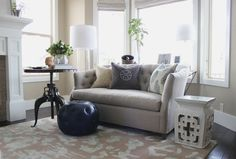 Neutral living room with tufted settee