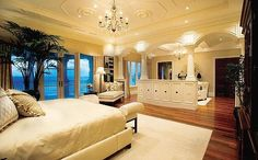 Master bedroom luxury. Nice way to divide the space without taking away from it