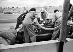 A pit stop and driver change for the #7 Alfa of Peter Revson and Rolf Stommelen.  Revson is about to exit the car and Stommelen about to enter.  Note the Goodyear tire man checking the front tires.  Revson was contractually obligated to Goodyear for any car he drove.  Alfa however was using Firestone tires on the other cars and they had some issues with those tires during practice that didn't make them happy.  (Photo by Lou Galanos)