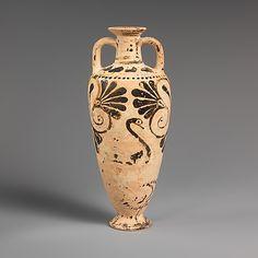 Terracotta amphoriskos (oil flask)    Period:      Archaic  Date:      ca. 550–525 B.C.  Culture:      East Greek, Milesian, Fikellura  Medium:      Terracotta  Dimensions:      H. 9 5/16 in. (23.7 cm)  Classification:      Vases