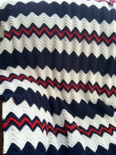 crochet ripple afghan in navy blue, white and red