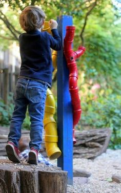 Simple, inexpensive and would keep them busy! PVC Pipe joints for outside play exploration mounted to wood post / outdoor play / backyard play / backyard toys for toddler / kids
