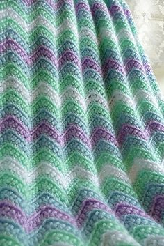 Ravelry: buttercup11's 0133 - Rickrack Rainbow Baby Blanket; link to free pattern
